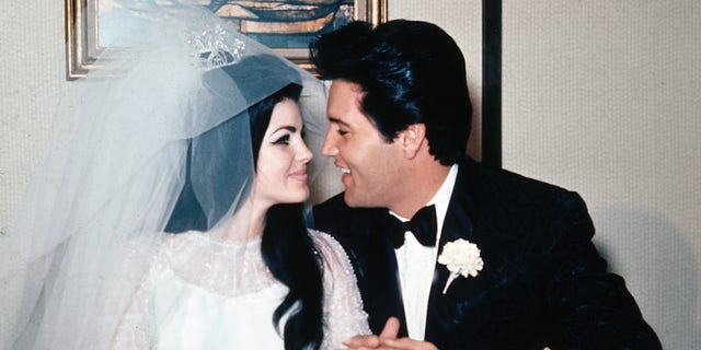 Singer Elvis Presley and his bride, the former Priscilla Beaulieu, are shown at the Aladdin Hotel in Las Vegas, Nev., after their wedding on May 1, 1967. Presley, 32, and Beaulieu, 21, both from Memphis, Tenn., met while he was stationed in Germany with the U.S. Army. (AP Photo)