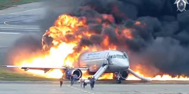 Passengers evacuate from Aeroflot Flight 1492 at Moscow's Sheremetyevo Airport after it caught fire during a hard landing on May 5, 2019.