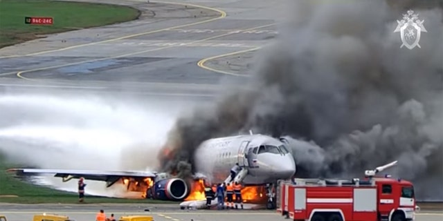 Emergency responders arrive after Aeroflot Flight 1492 caught fire during a hard landing on May 5, 2019 at Moscow's Sheremetyevo Airport.