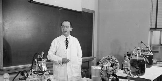 FILE - In this April 8, 1955 file photo, Dr. Jonas Salk, developer of the polio vaccine, describes how the vaccine is made and tested in his laboratory at the University of Pittsburgh. (AP Photo)