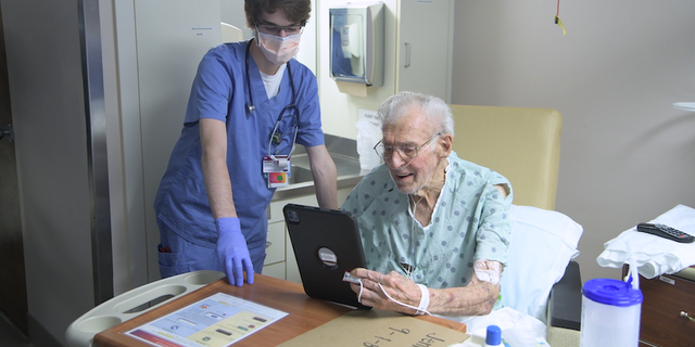 A patient talks with a loved one with an iPad in his hospital room in South Carolina.