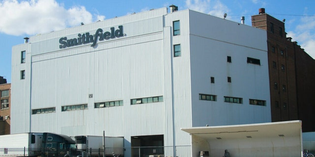 """""""We believe it is our obligation to help feed the country, now more than ever,"""" the CEO of Smithfield Foods said Sunday. """"We have a stark choice as a nation: we are either going to produce food or not, even in the face of COVID-19."""""""