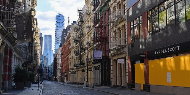 Boarded up storefronts are seen in the SoHo neighborhood of New York City on April 1, 2020. - The US on Wednesday has surpassed 200,000 confirmed cases of the novel coronavirus, according to a tally kept by Johns Hopkins University.