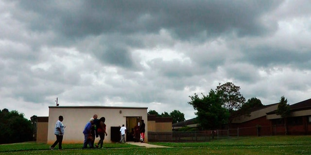 In this April 29, 2014 file image taken from video, people enter a community storm shelter during a tornado watch in Tuscaloosa, Ala.