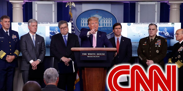 President Donald Trump speaks about the coronavirus in the James Brady Press Briefing Room of the White House, Wednesday, April 1, 2020, in Washington, as from left, Adm. Karl Leo Schultz, commandant of the Coast Guard, national security adviser Robert O'Brien, Attorney General William Barr, Defense Secretary Mark Esper, Chairman of the Joint Chiefs Gen. Mark Milley, and Navy Adm. Michael Gilday, Chief of Naval Operations, listen. (AP Photo/Alex Brandon)