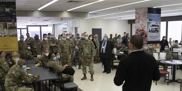 Shereef Elnahal, the president and CEO of University Hospital in Newark, N.J., welcoming soldiers from U.S. Army's Urban Augmentation Medical Task Force 332-1, 332nd Medical Brigade during orientation at the hospital Tuesday.