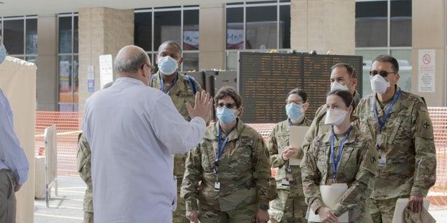 Dr. Mark Einstein (left) of University Hospital giving a tour.