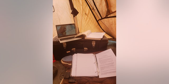 Inside Cadet William Taylor's tent where he is completing his college semester after the coronavirus pandemic.