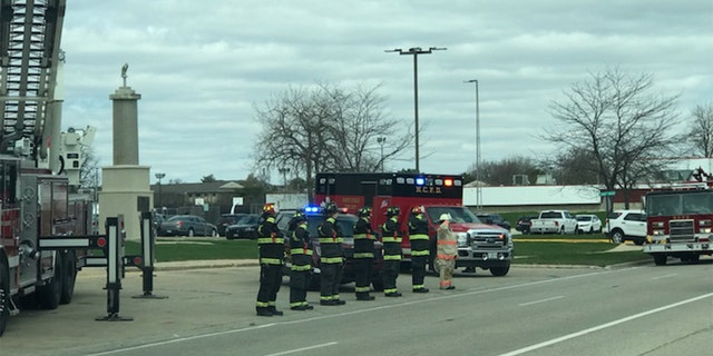 Waukegan firefighters saluted as hearse passed by.