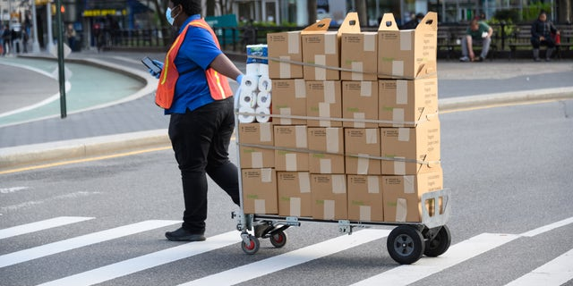 Amazon Fresh delivery person works in Union Square during the coronavirus pandemic on April 14, 2020 in New York City.