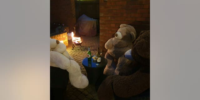 A mother-of-four who cannot bear the boredom of isolationis keeping her family entertained by posing giant teddy bears performing daily tasks.