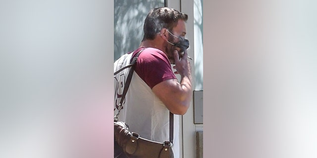 Actor Ben Affleck smokes a cigarette on the street in Los Angeles while out and about running errands.