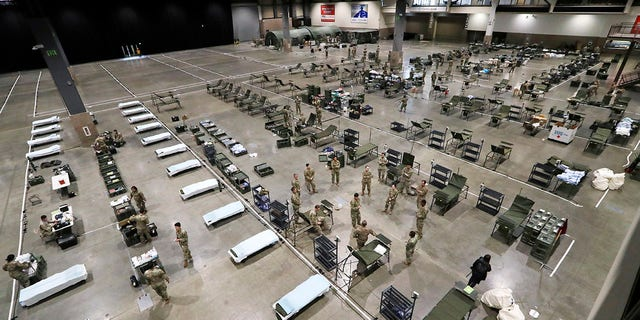 Inslee's decision comes just days after nearly 300 soldiers finished building the makeshift hospital. (AP Photo/Elaine Thompson)