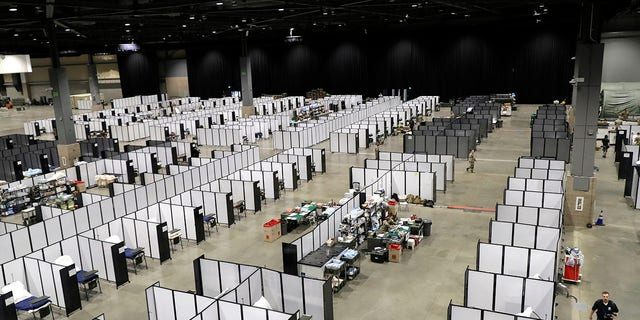 Rows of patient beds are shown at a military field hospital at the CenturyLink Field Event Center in Seattle on Sunday. (AP Photo/Ted S. Warren)