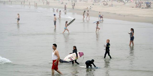 Calif. Governor Warns That Packed Beaches Put Coronavirus Pandemic Progress At Risk