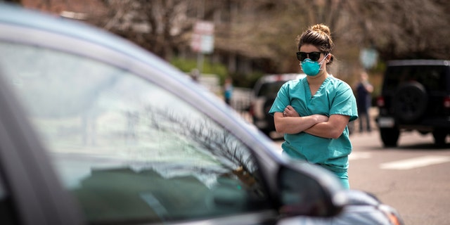 Colorado health care workers block antiquarantine protesters amidst coronavirus pandemic