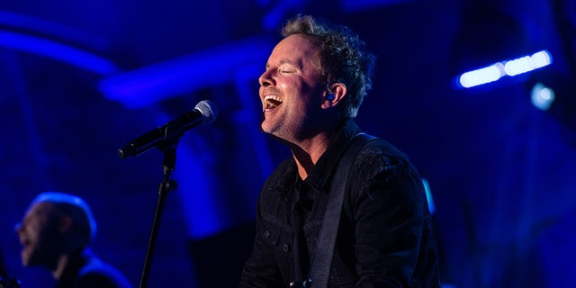 Chris Tomlin, a popular Christian singer, leads worship during a global Good Friday service that will be streamed online, TV, and radio stations to millions.
