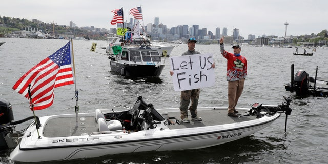 Washington anglers protested by boat on a Seattle lake over the weekend, calling for the state to lift its ban on recreational fishing amid the coronavirus pandemic.(AP Photo/Ted S. Warren)