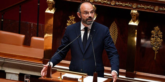 Philippe presents his plan to exit from the lockdown at the National Assembly in Paris on Tuesday. (David Niviere, Pool via AP)