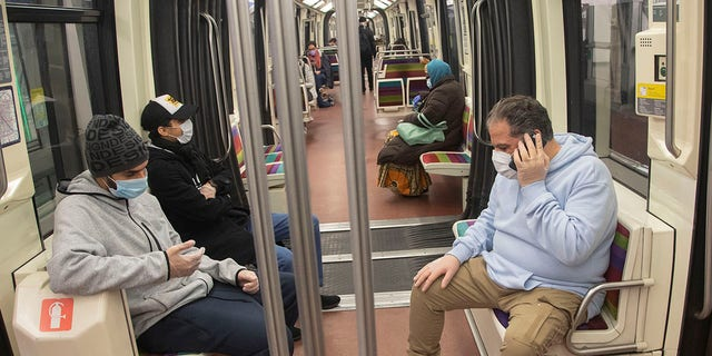 People wear masks and gloves to protect against the spread of the coronavirus as they ride a subway Paris on Tuesday. (AP Photo/Michel Euler)