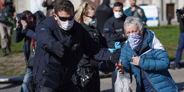 Germany has drafted a plan which will require citizens to wear masks in public if the country's lockdown is lifted on April 19. (Joerg Carstensen/dpa via AP)