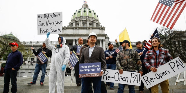 Protesters demonstrate at the state Capitol in Harrisburg, Pa., Monday, April 20, 2020.. (AP Photo/Matt Rourke)