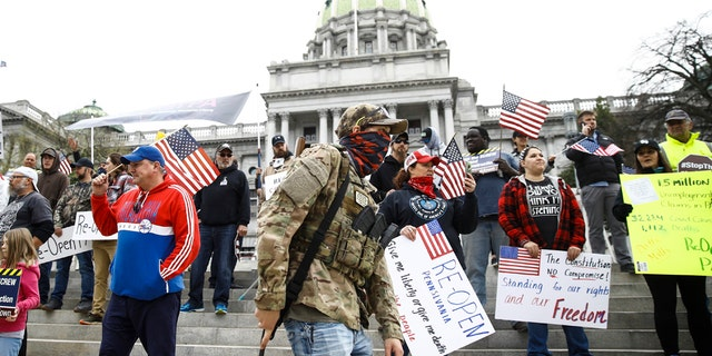 Protesters demonstrate at the state Capitol in Harrisburg, Pa., Monday, April 20, 2020, demanding that Gov. Tom Wolf reopen Pennsylvania's economy even as new social-distancing mandates took effect at stores and other commercial buildings. (AP Photo/Matt Rourke)
