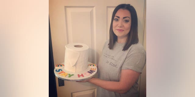 """Lisa Jamieson, 38, baked the chocolate fudge sponge cake on Tuesday evening, iced to look like a toilet roll, and emblazoned with icing letters spelling out """"STAY HOME."""""""