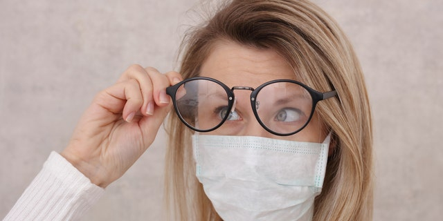 Wearing a tissue under the top of your mask can also help to prevent lenses from fogging. (iStock)