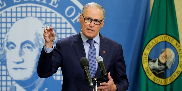 FILE - In this Monday, April 13, 2020, file photo, Washington Gov. Jay Inslee speaks during a news conference at the Capitol in Olympia, Wash. (AP Photo/Ted S. Warren, File)