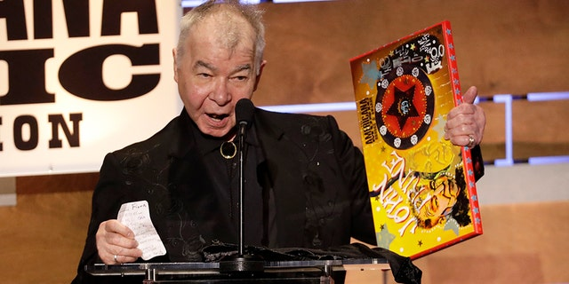 FILE - In this Sept. 11, 2019 file photo, John Prine accepts the Album of the Year award at the Americana Honors & Awards show in Nashville, Tenn.聽