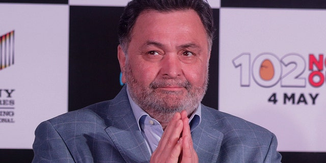 New World Trend Entertainment News - In this April 19, 2018 file photo, Bollywood actor Rishi Kapoor greets media as he arrives for the song launch of film '102 Not Out' in Mumbai, India.