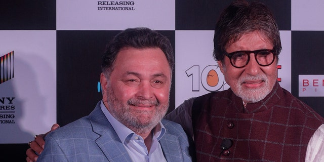 Bollywood actor Rishi Kapoor, left poses with actor Amitabh Bachchan the song launch of film '102 Not Out' in Mumbai, India.