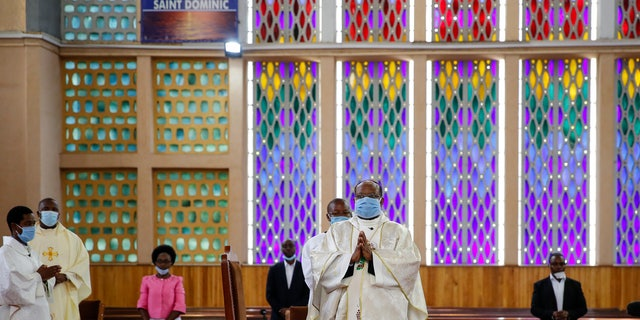 Priests conduct a service without a congregation, but which was broadcast on television, at the Cathedral Basilica of the Holy Family in Nairobi, Kenya, on Easter Sunday. (AP)