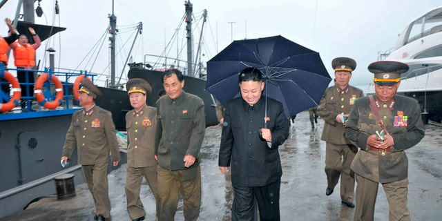 Kim Jong-un is seen inspecting the fishery station at Wonsan on North Korea's east coast in thie 2013 photo, with a luxury yacht seen in the background.