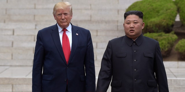 "FILE- In this June 30, 2019 file photo, President Donald Trump, left, meets with North Korean leader Kim Jong Un at the North Korean side of the border at the village of Panmunjom in Demilitarized Zone. North Korea on Sunday dismissed as ""ungrounded"" President Donald Trump's comment that he recently received ""a nice note"" from the North's leader, Kim Jong Un. (AP Photo/Susan Walsh, File)"