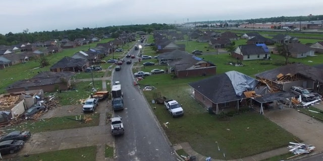 Drone video from the Monroe Fire Department showed several homes completely destroyed by a tornado, with roofs ripped completely off.
