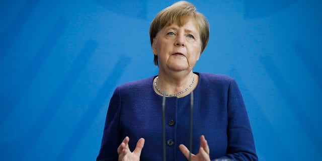 Merkel briefed the media about measures the German government is taking to avoid further spread of the coronavirus at the chancellery in Berlin on Monday. (AP Photo/Markus Schreiber, Pool)