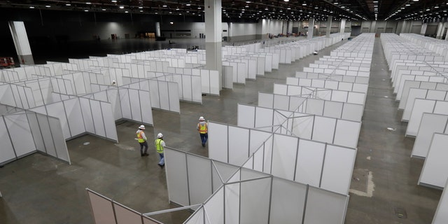 In this April 1, 2020, photo the interior of the TCF Center with temporary hospital rooms is seen inside the convention center in Detroit.
