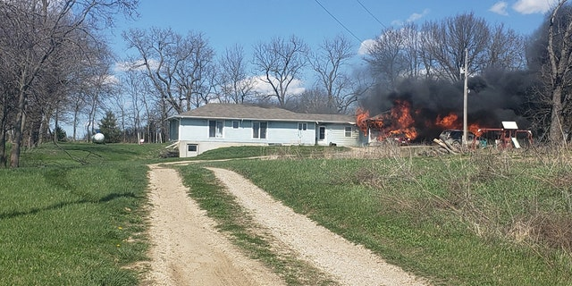 The Villegas family's home burning down in Odessa, Mo., on Sunday. The family lost everything in the fire but their town rallied together to help them.