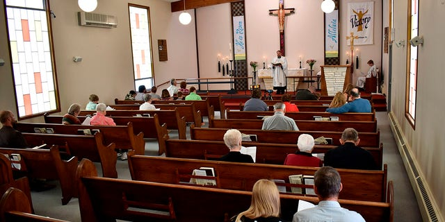 Members of Christ the King Lutheran Church in Billings, Montana sing a hymn during a service Sunday following a phase-in reopening of businesses and gathering places as infection rates from the coronavirus decline in the state. (AP Photo/Matthew Brown)