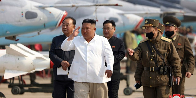 In this undated file photo provided by the North Korean government on April 12, 2020, North Korean leader Kim Jong Un inspects an air defense unit in western area, North Korea.