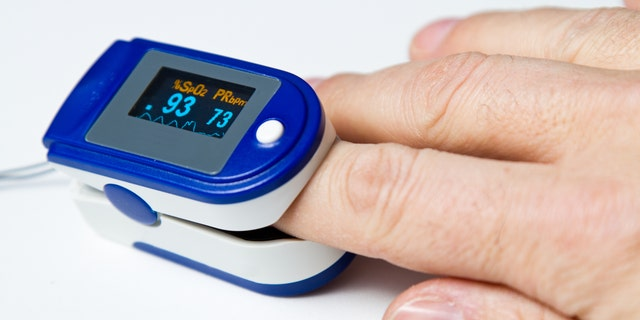 A pulse oximeter is a non-invasive way to monitor oxygen saturation in a person's blood.