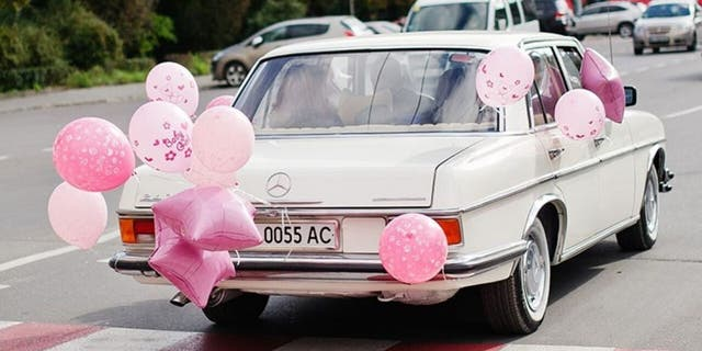 """In a """"car parade,"""" people adorn their vehicles with decorations like balloons, signs and streamers, then drive by a loved one's residence."""