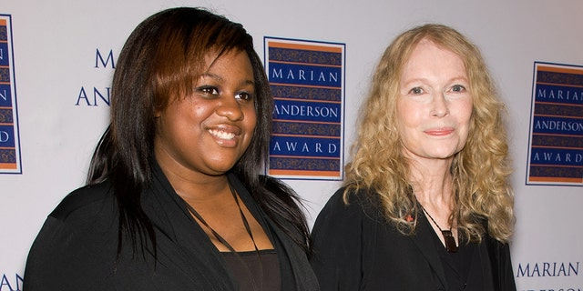 Mia Farrow (R) and daughter Quincy Farrow attend the 2011 Marian Anderson award gala honoring Mia Farrow at the Kimmel Center for the Performing Arts on May 10, 2011.