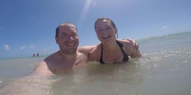 Cassie and Simon Woods in the sea in the Dominican Republic in 2018.
