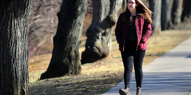 Alexis Rickmers walks around Chandler Pond and Gallagher Park in Boston on March 18, 2020. She is among many people suffering from anxiety, paranoia, and hypochondria amid the coronavirus. She says daily walks help. (Photo by Lane Turner/The Boston Globe via Getty Images)