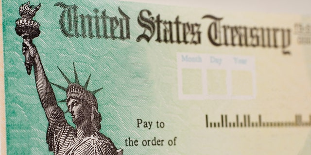 Government stimulus checks to help during the economic downturn caused by the coronavirus pandemic were direct deposited in bank accounts of some US citizens on Wednesday, April 15, 2020 - including some dead people's accounts, reports said. (iStock)