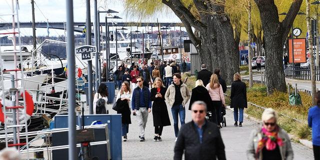 People taking a stroll Sunday in Stockholm, Sweden. (Fredrik SANDBERG / TT News Agency / AFP via Getty Images)