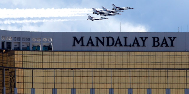 The U.S. Air Force Air flight demonstration squadron, the Thunderbirds, flies by the Mandalay Bay hotel-casino as they show their support for frontline COVID-19 health care workers and first responders in Las Vegas, Saturday, April 11, 2020.